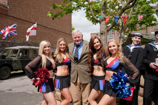 DYX0M3 West Wickham,UK,26th April 2014,Colonel Bob Stewart poses for a photo with sailors and the Crystal Palace cheer leaders who were collecting money for the Help for Heroes charity©Keith Larby/Alamy Live News