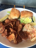 Snapper sandwich on an onion roll with rémoulade and house-made chips at Louie's Backyard - 700 Waddell Avenue, Key West - louiesbackyard.com