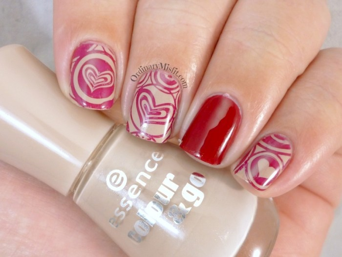 Red on nude stamped nail art