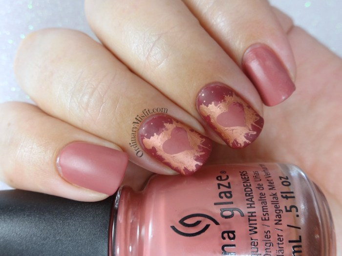 Splattered hearts nail art