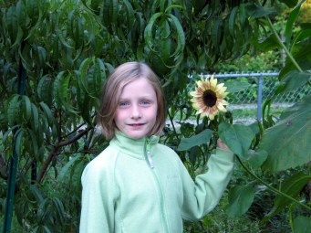 Middle Daughter with one of her sunflowers