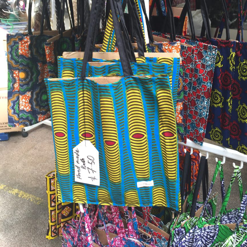 A handmade bag using traditional African textiles from The Wig Bazaar