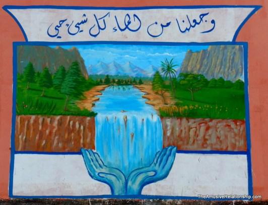 Near a well that serves a neighboring village