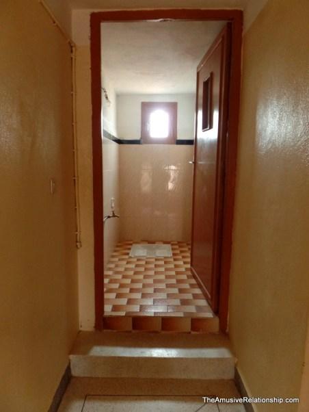 Second floor bathroom with a turk.