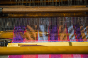 calculation of weaving cost and profit, Weaving Fabric in a Loom