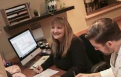 Dr. Samuel Oltman, ND, at Oregon Regenerative Medicine's front desk with patient and receptionist