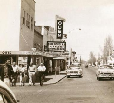 Men walking past Odem Theater, 1955 (Image source: Odem Theater Pub Facebook Page)