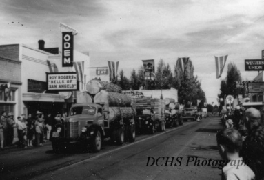 Odem theater over local loggers participating in a parade, 1947 (DCHS)