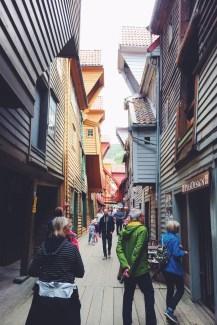 Wade with tourists through Bryggen in Bergen