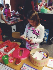 Reading your notes at the Valentine's Dy party at school American