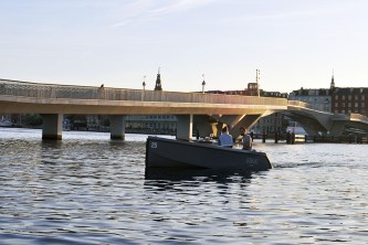 GoBoat on Copenhagen Canal Near Inner Harbor Bridge | Rent an Electric Picnic Boat and Cruise the Copenhagen Canals | 10 Must Do's This Summer in Copenhagen | Oregon Girl Around the World