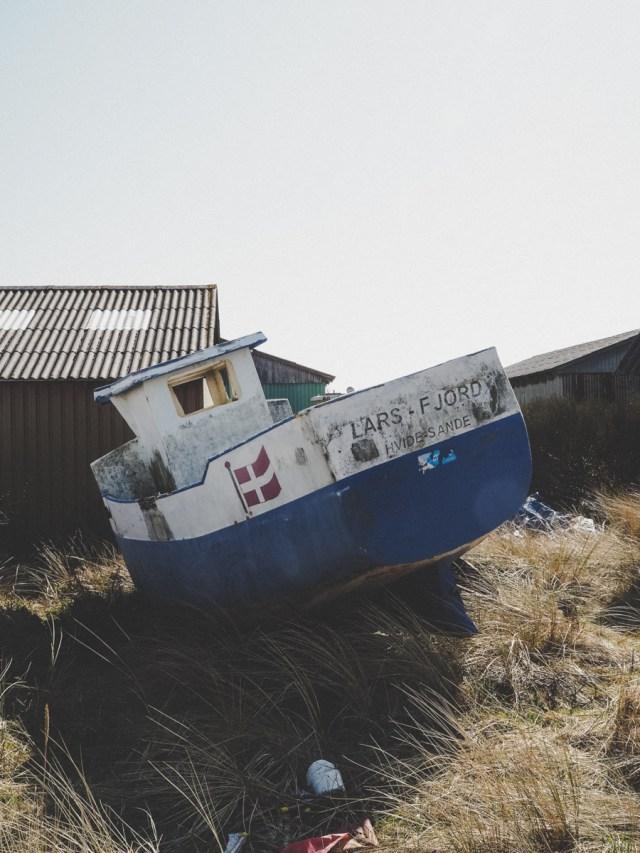 Old boat in fishing village of Tyskerhavnen Hvide Sande west coast of Denmark