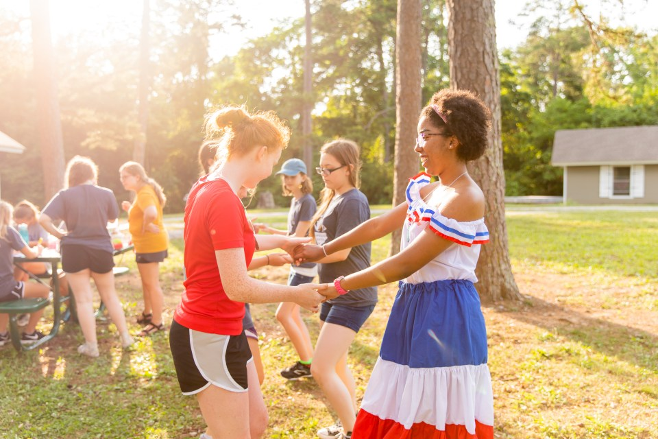 Campers learning a traditional Dominican dance.