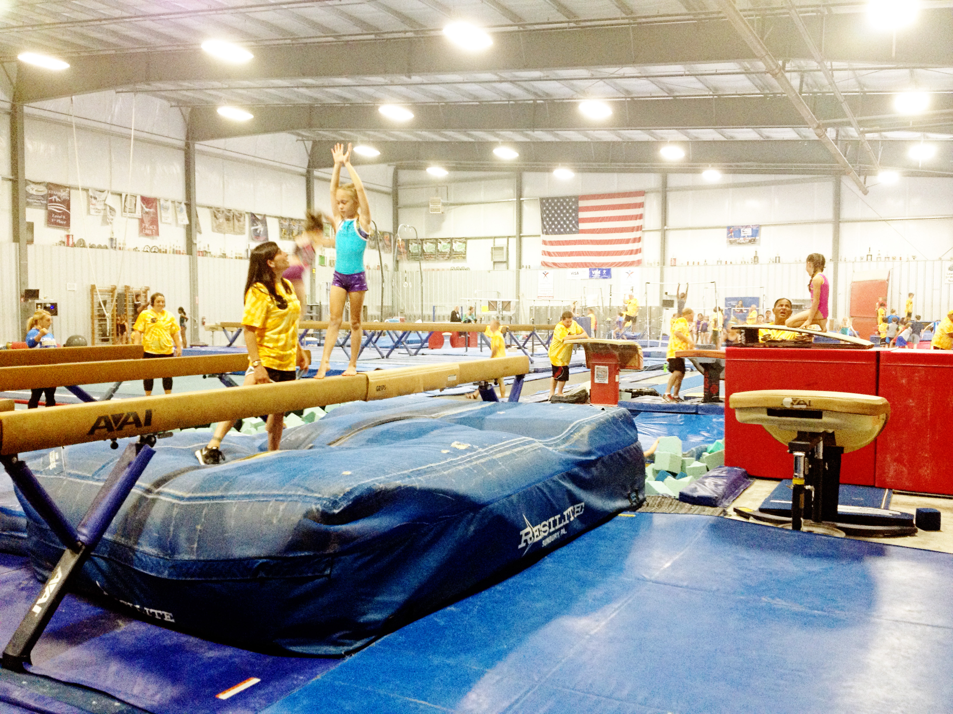 Oregon Olympic Athletics Coach Mohini teaching  beam as a guest coach at Dan Alch's camp of Champions.
