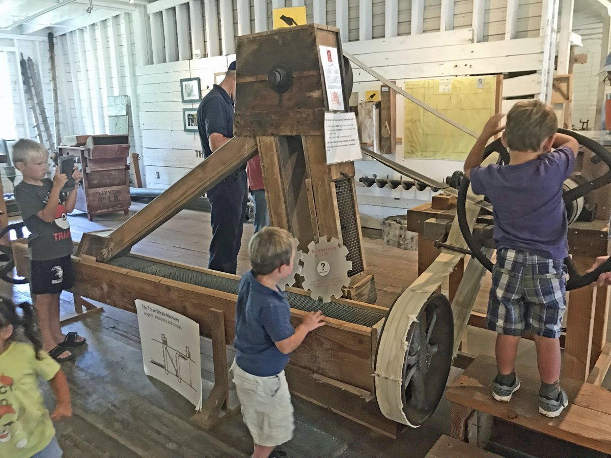 Our two middle kids inspect the auger at Thompson's Mill