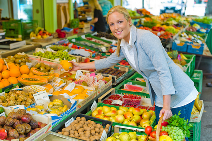 woman at the fruit market with shopping basket