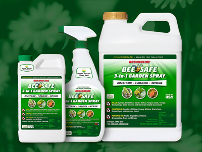 three sizes of organocide bee safe three-in-one garden spray against background of daisies