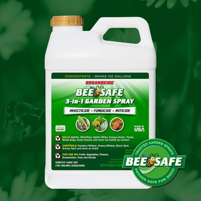 green and white gallon container of bee safe organic pest garden spray concentrate twist on cap over green flower field