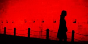 Ghostly silhouette against red background