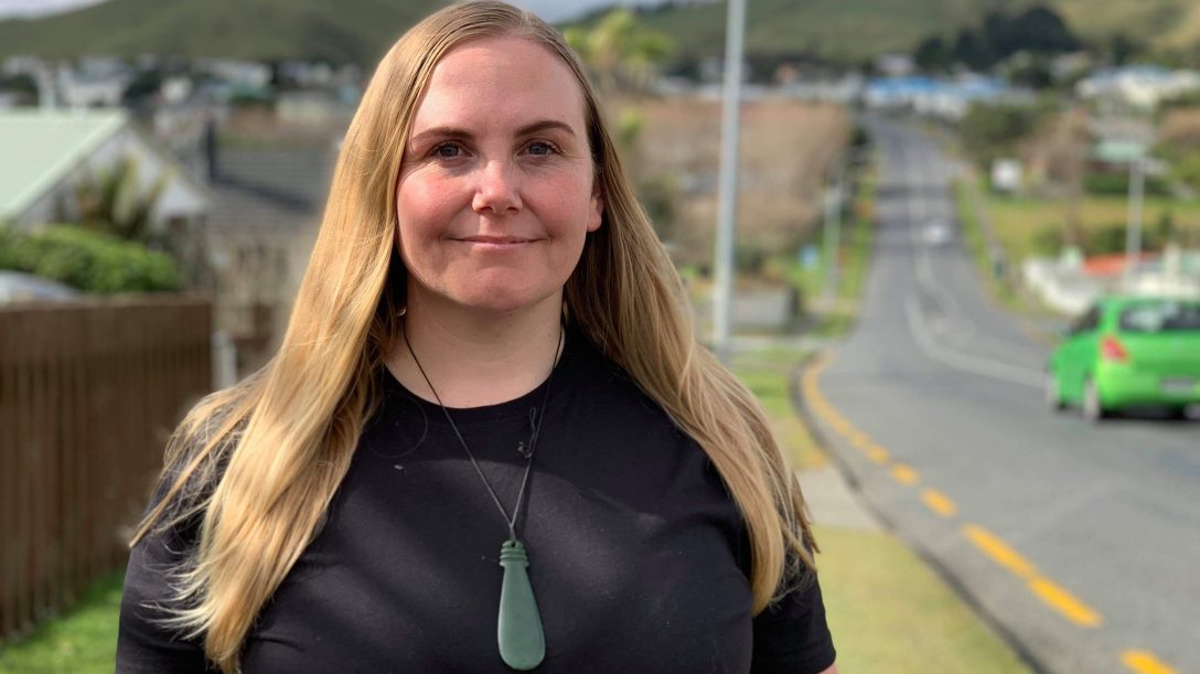 Picture of Jasmine with backdrop of a Porirua street