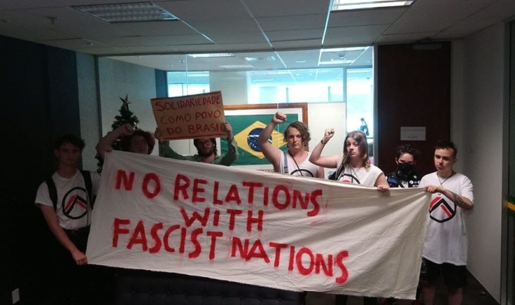 "OA members occupy the Brazilian embassy with a banner that reads ""No relations with fascist nations."""