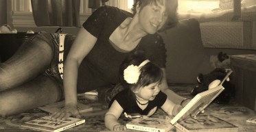 Denise Reashore, an elementary school teacher, spends time with her little one enjoying a good book on Family Literacy Day.