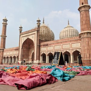 Colorful robes visitors wear inside the Jama Masjid mosque grounds