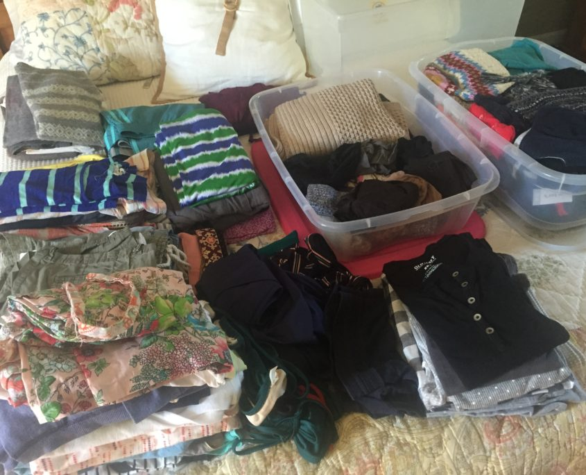 Piles, piles and piles of clothes - some will stay and many will go!