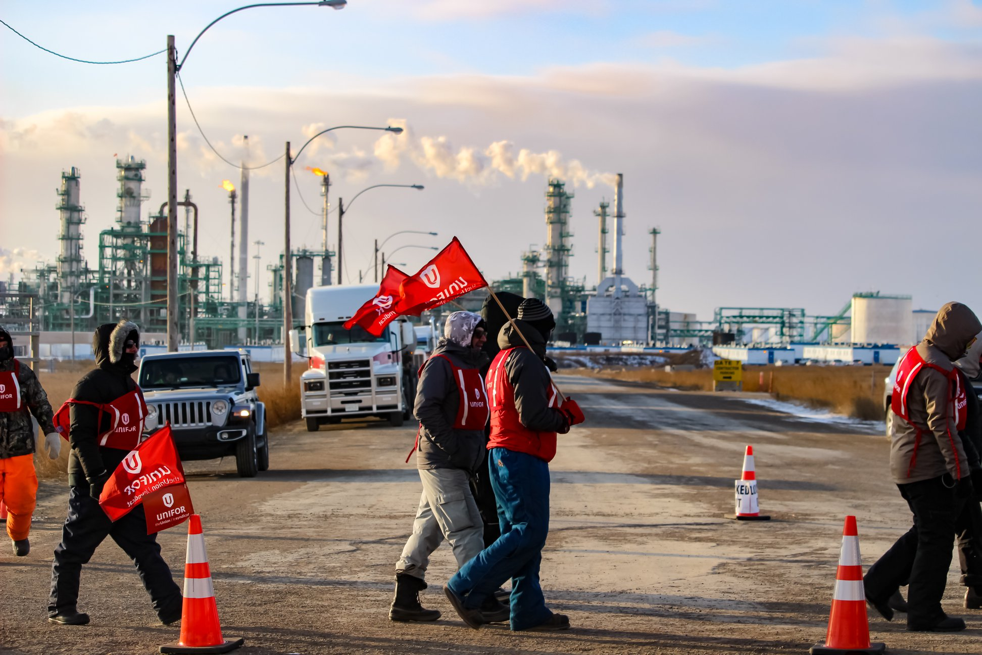 Workers at a cooperative refinery walk the picket line