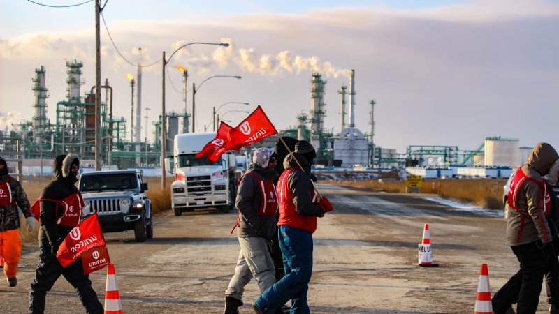 Unifor 594 members walk the picket line after being locked out by the Co-operative Refinery Complex