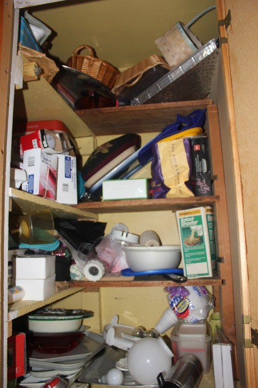Tupperware and Troubled Corners - messy corner cabinet
