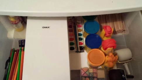 a grandchildrens play closet - organized art supplies in drawer