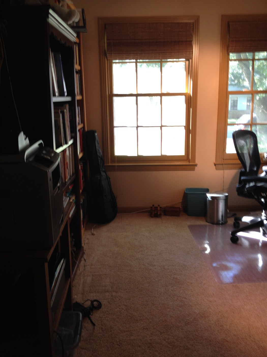 Purging Outdated Technology in a Home Office Closet - Decluttered Home Office Corner