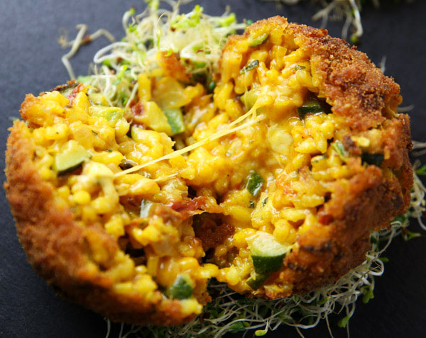 Arancini di Riso is an Italian dish used with leftover Risotto. We stuffed the Risotto with Mozzarella, breaded it, and fried it. This is so delicious!!