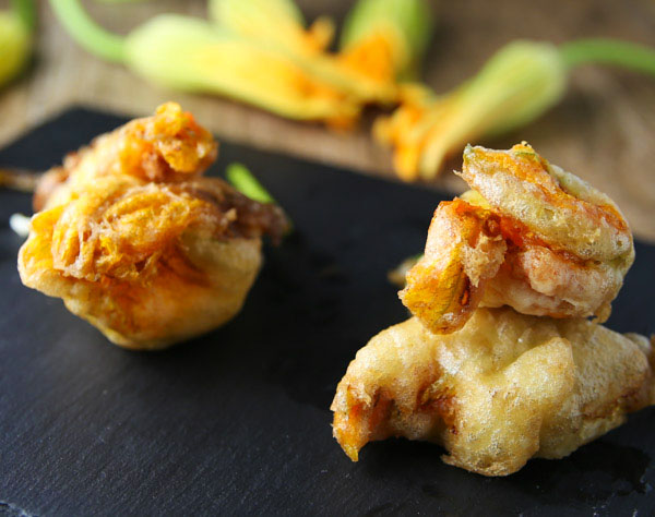 These Stuffed Zucchini Blossoms (Fiori Di Zucca Ripieni) are such a delicate, delicious appetizer! Stuffed with anchovies and mozzarella, then deep fried for perfection!