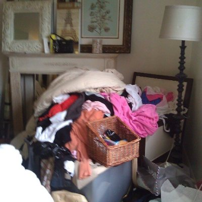 De-cluttering single woman's bedroom