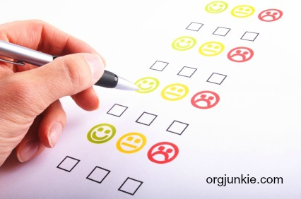 hand pen and checkbox or tickbox with smilie