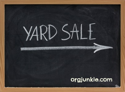 yard sale text handwritten with white chalk on blackboard