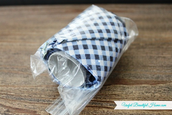 Place in a re-usable zip lock baggie to keep the tie from unrolling while traveling
