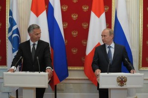 Vladimir Putin and Didier Burghalter after talks in Moscow on May 7, 2014.