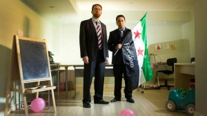 Louay Sakka (R) is an executive member of the US-based Syrian Support Group. He often works out of an office space in his basement in Oakville, ON. His childhood friend, Anas Al-Kassem (L), is a fellow Syrian activist.