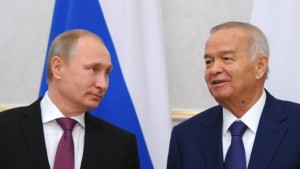 Russian President Vladimir Putin (L) and Uzbek President Islam Karimov attend a meeting at Kuksaroy residence in Tashkent on December 10, 2014.