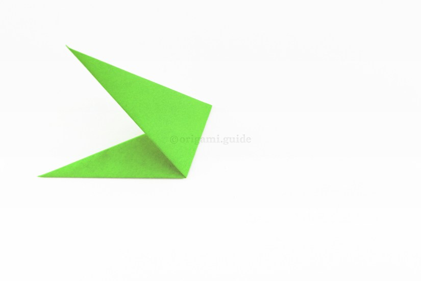 15. Fold the right of the shape up and to the left at an angle, it will be guided by inner flaps inside.