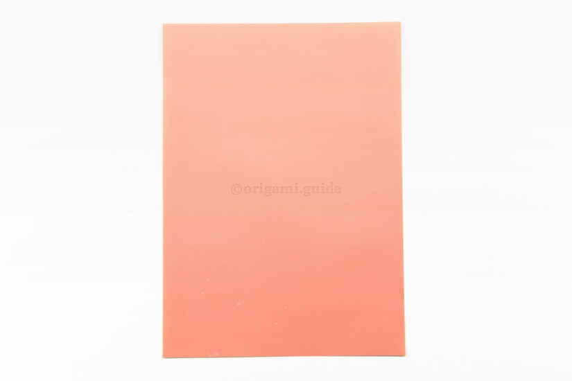 1. This is the back of the paper, which is usually white. This colour will end up being the hat's rim.