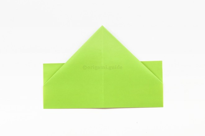 8. Flip your origami hat over to the other side.