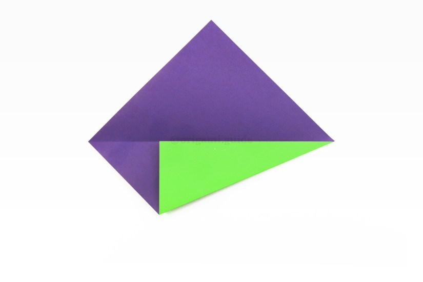4. Fold the bottom right diagonal edge and fold it up to align with the central crease.