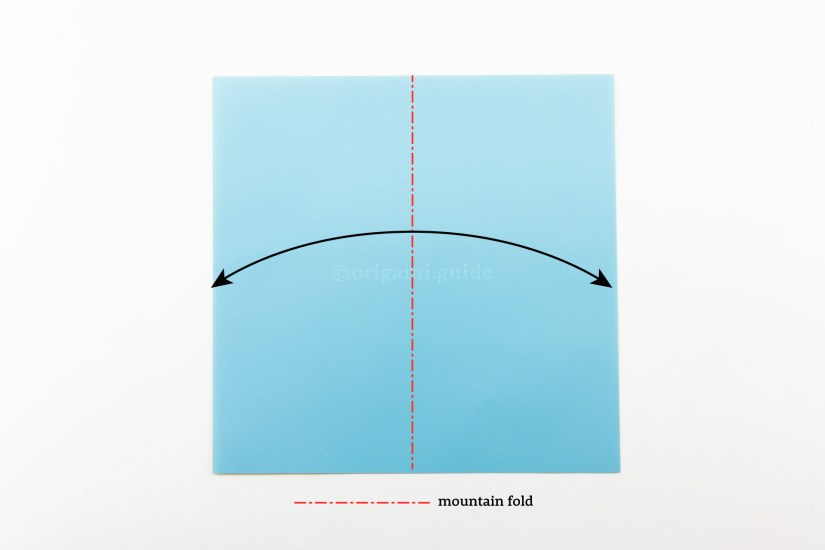 4. Mountain Fold. The mountain fold is symbolised by a red line with alternating dashes and dots. To make a mountain fold, you will need to turn the paper over to the other side and fold it in half.