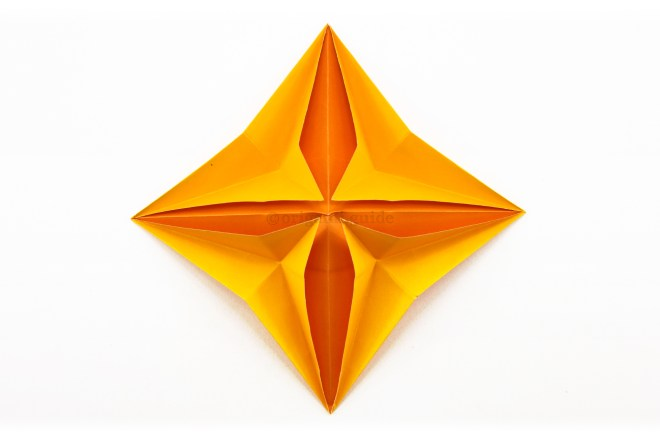 21. Pull the points out until the star looks as shown.