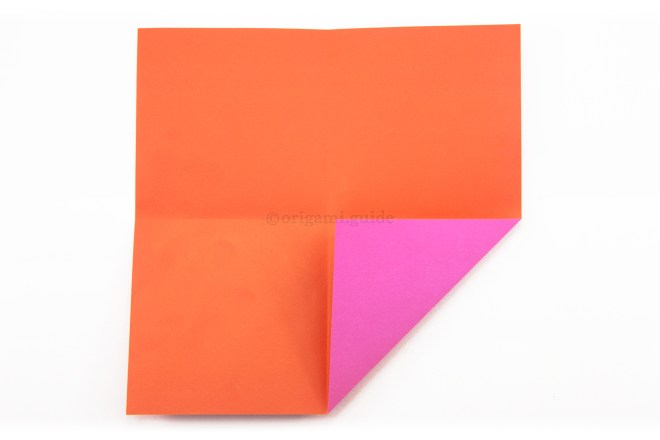 6. Fold the bottom right corner to the middle of the paper.