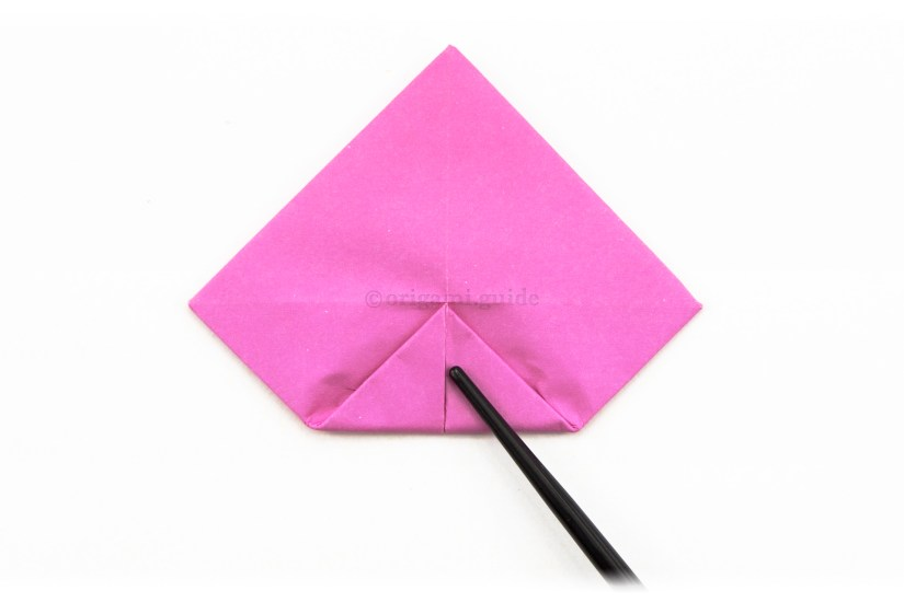15. Fold the bottom point to the center.
